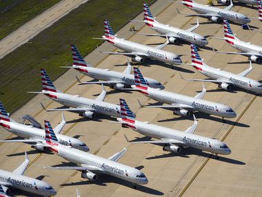 Aerial view of some of the 25 American Airlines aircraft parked on the ramp to the south of Terminal D at Dallas Fort Worth (DFW) International Airport on Thursday, April 16, 2020.