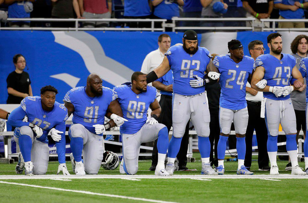 Members of the Detroit Lions knelt during the playing of the anthem before their game against the Arizona Cardinals last month.