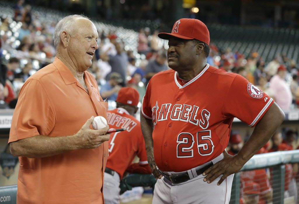Former Houston Astros pitcher Nolan Ryan, left, talks with Los Angeles Angels batting coach Don Baylor (25) before the baseball game against the Astros Tuesday, Sept. 2, 2014, in Houston. (AP Photo/Pat Sullivan)