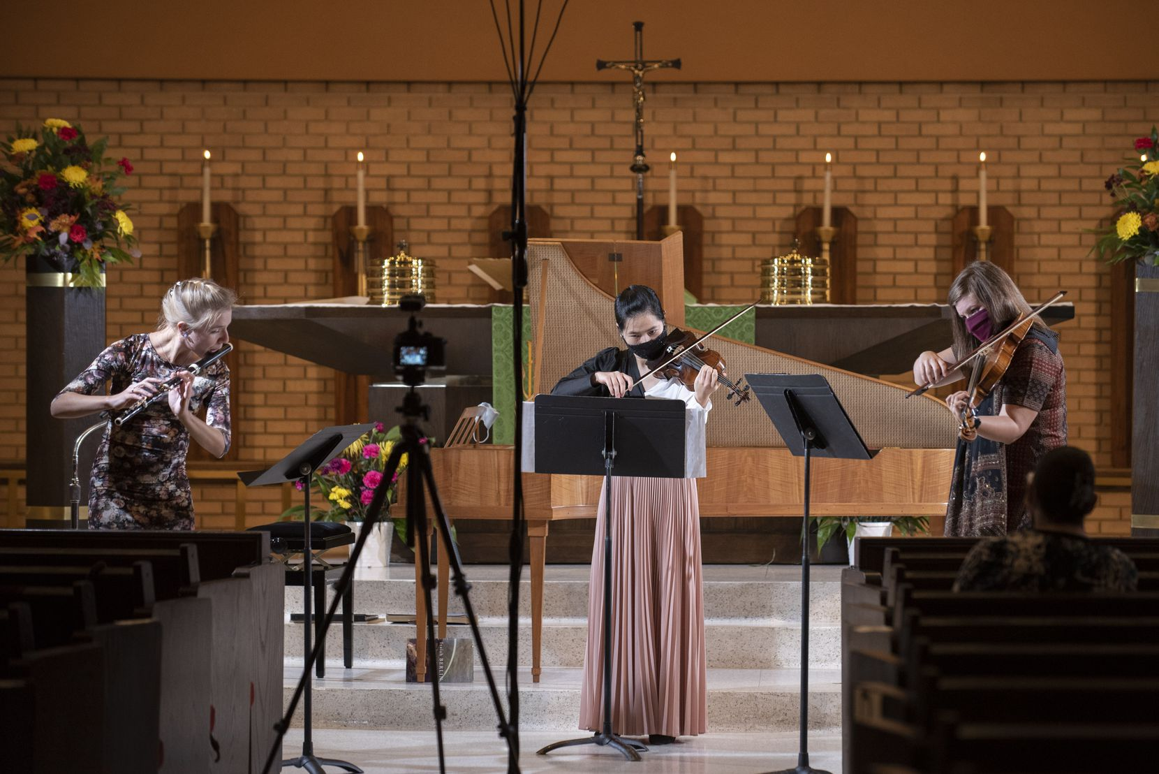 Flutist Taya König-Tarasevichn, violinists Ha Viet Dang (center) and Stephanie Noori perform Beethoven's Serenade for Flute, Violin and Viola, Opus 25, for the Dallas Bach Society at the Zion Lutheran Church in Dallas.