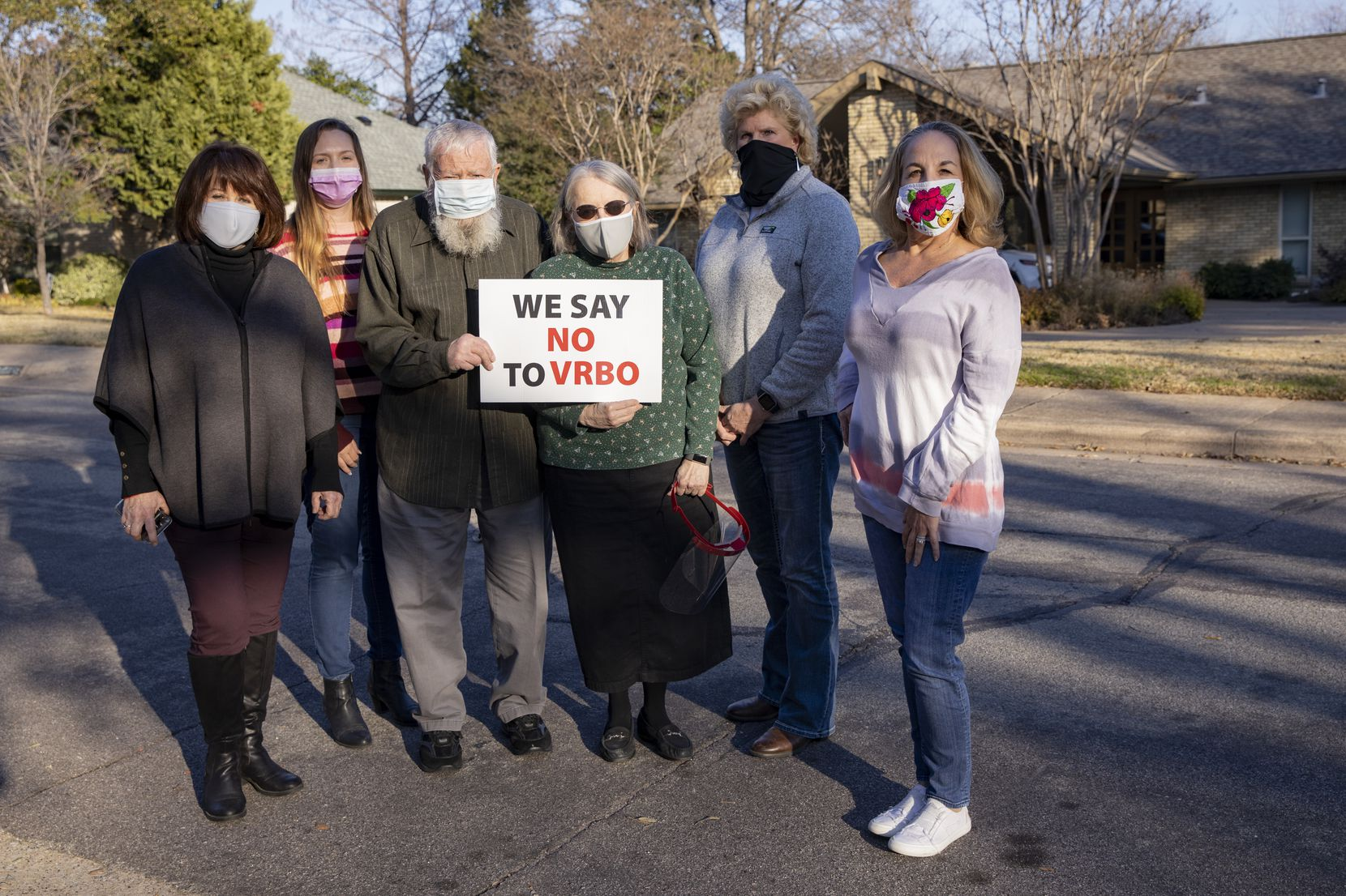 Among the Lochwood residents who have expressed concern about the short-term rental in their neighborhood are, from left, Caton Cadigan, Mary Nagler, John and Terry Kohl, Sharolyn Parker and Shelby Gibbs.