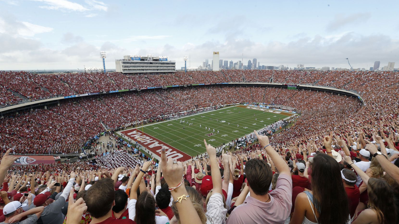 FILE - Oklahoma fans yell as Texas kicks the ball off to start the Red River Showdown at the Cotton Bowl in Dallas on Saturday, Oct. 6, 2018.