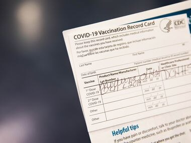 Gladys Rodgers, 77, holds her COVID-19 vaccination card at Fair Park in Dallas on Thursday, Jan. 14, 2021. (Juan Figueroa/ The Dallas Morning News)