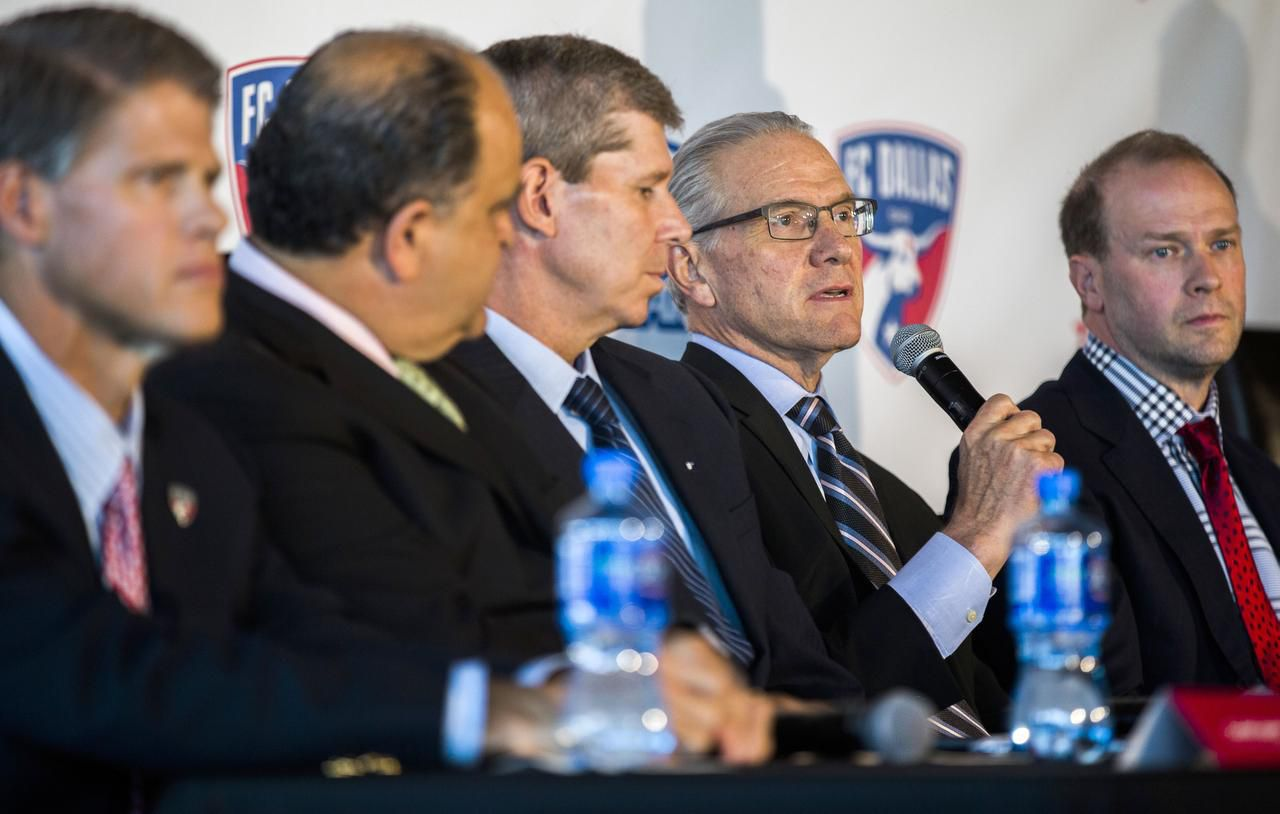 U.S. Soccer CEO and Secretary General Dan Flynn (second from right) answers media questions about the new home in Frisco for the National Soccer Hall of Fame.