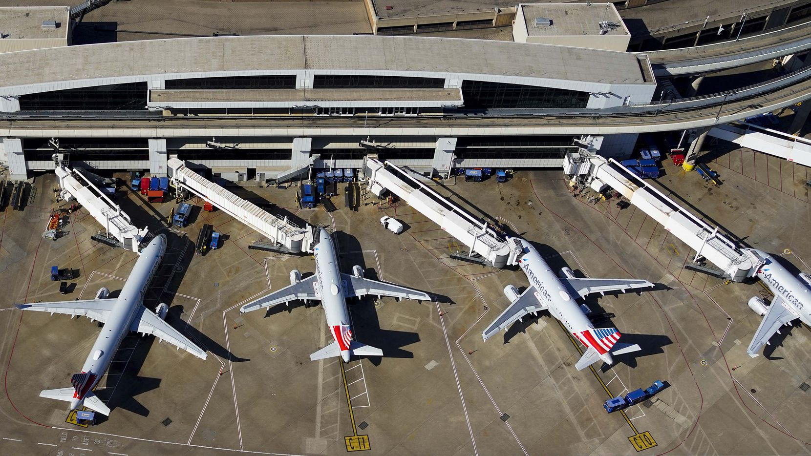 Aerial view of American Airlines aircraft at the gates of Terminal C at Dallas Fort Worth (DFW) International Airport on Thursday, April 16, 2020.
