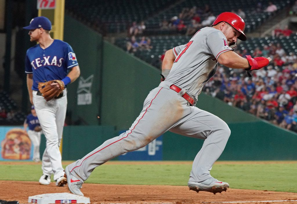 Los Angeles Angels 'Mike Trout rounds third base as he heads home to score during the sixth inning of the team's baseball game against the Texas Rangers on Wednesday, Aug. 21, 2019 in Arlington, Texas. (AP Photo/Louis DeLuca)