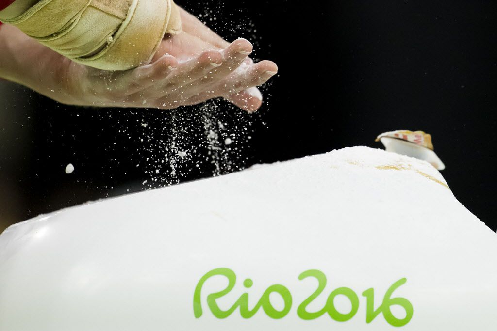USA gymnast Madison Kocian of Dallas chalks her hands before practicing on the balance beam during a training session at the Rio Olympic Arena on the day before the opening ceremonies of the Rio 2016 Olympic Games on Thursday, Aug. 4, 2016, in Rio de Janeiro. (Smiley N. Pool/The Dallas Morning News)