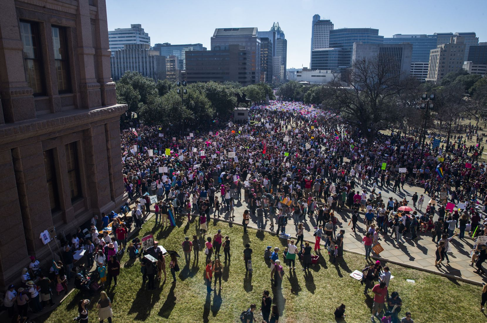 Thousands of demonstrators gather at the Texas state Capitol during the Austin Women's March on Saturday. The event was held in solidarity with the Women's March on Washington.