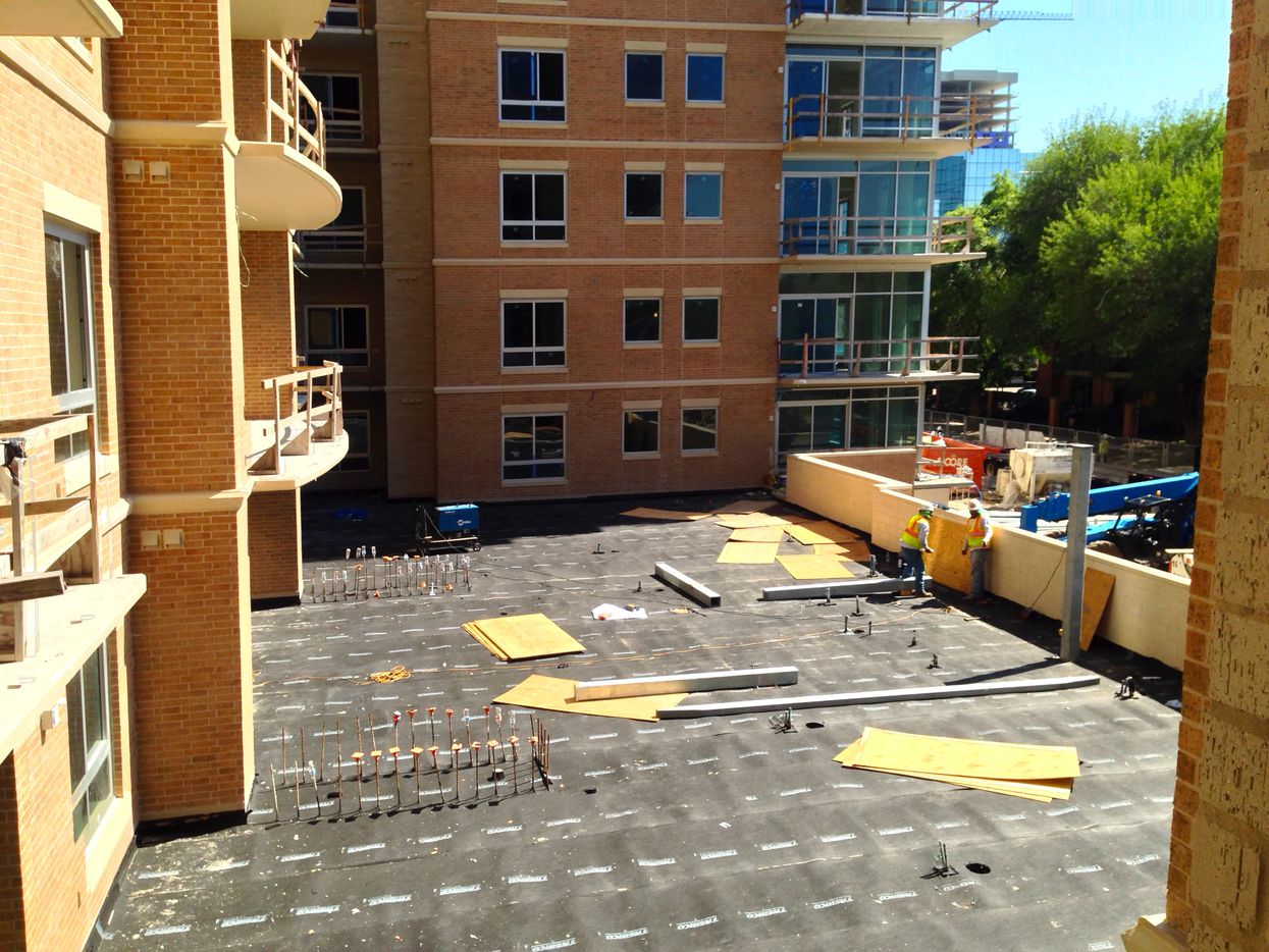 A front courtyard at The Katy apartment building is still under construction.