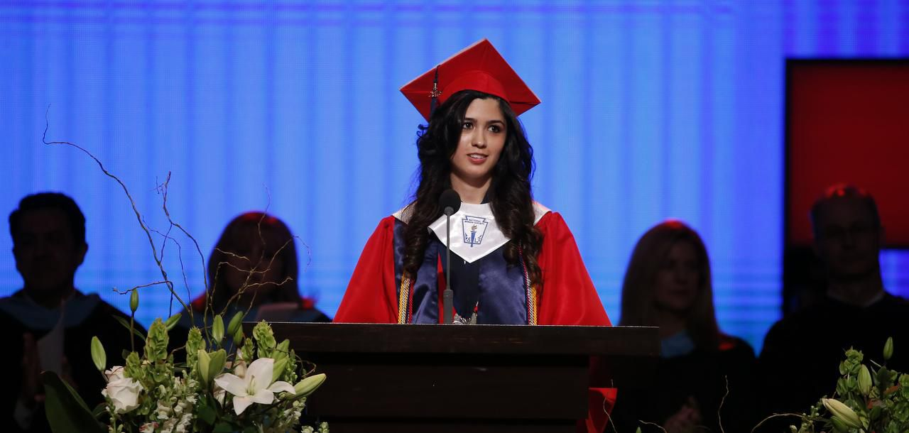 Valedictorian Larissa Yanin Martinez delivers a speech during the McKinney Boyd High School commencement ceremony on June 3, 2016.