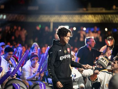Fans cheer for Huke (Cuyler Garland) as he takes the stage before Dallas Empire competes against Chicago Huntsmen in the Call of Duty League Launch Weekend at the Armory in Minneapolis, Minn., January 24, 2020.
