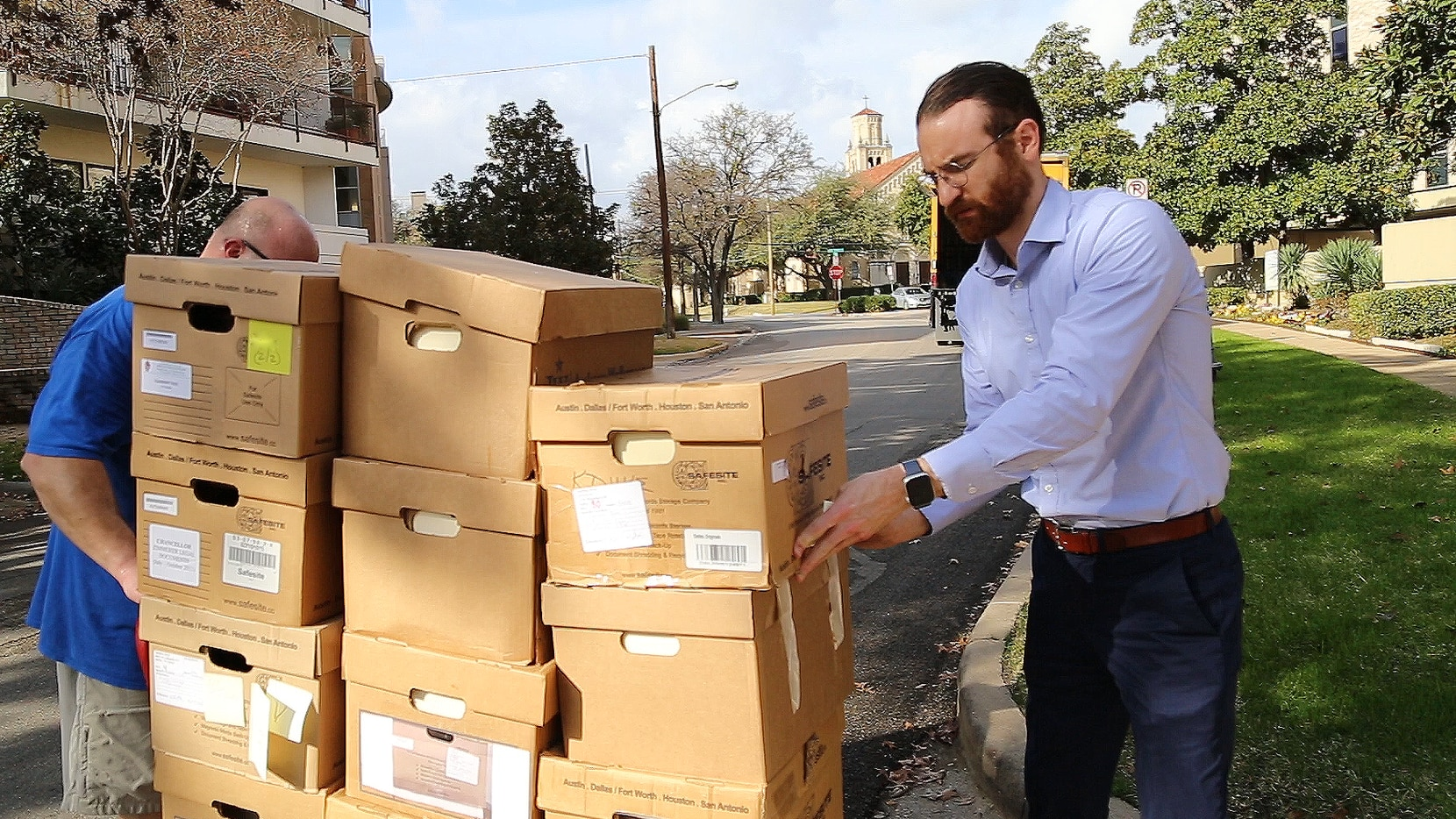 "Dallas Catholic Diocese Chancellor Greg Caridi accepts boxes of documents that police had seized on May 15, 2019. State District Judge Brandon Birmingham ordered that any record that ""exceeds the scope of the search warrant as written,"" to be returned by police to the diocese. Some records were also exempt from disclosure because they were protected by attorney-client privilege. This shipment of boxes was returned to the diocese's pastoral center on Nov. 7, 2019. Another shipment was returned Jan. 21, 2020."