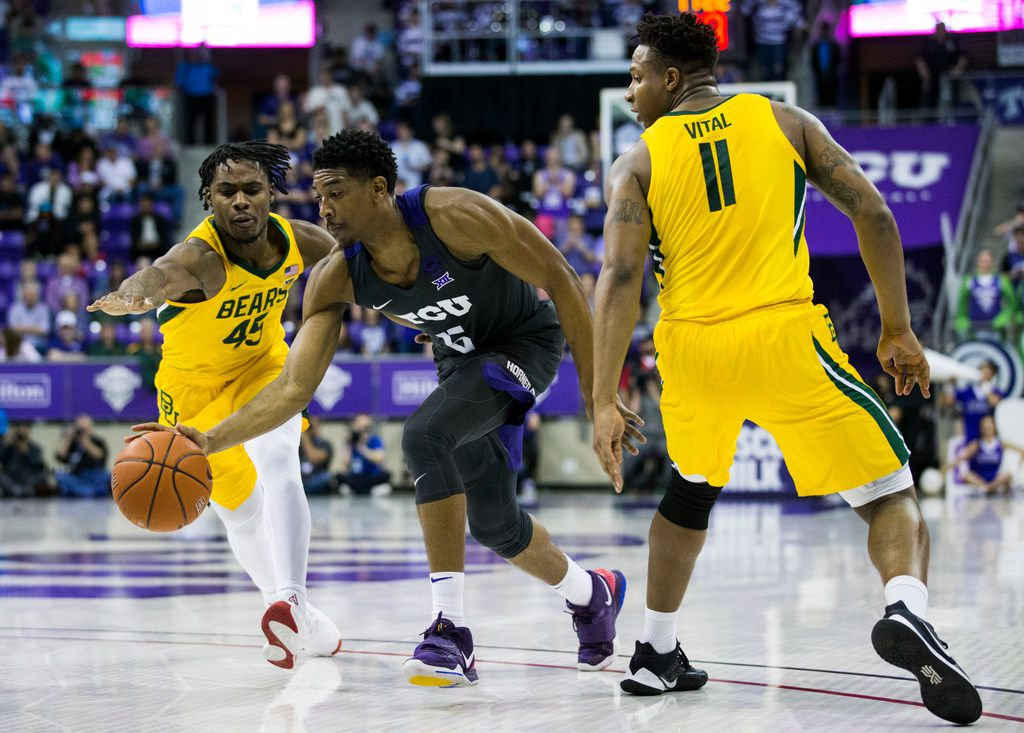 TCU Horned Frogs guard Jaire Grayer (5) finds a hole between Baylor Bears guard Davion Mitchell (45) and Baylor Bears guard Mark Vital (11) during the second half of an NCAA mens basketball game between Baylor and TCU on Saturday, February 29, 2020 at Ed & Rae Schollmaier Arena on the TCU campus in Fort Worth. (Ashley Landis/The Dallas Morning News)