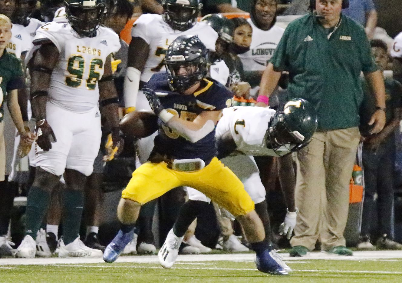 Highland Park High School running back Jay Cox (37) catches a pass and breaks away during the second half as Highland Park High School hosted Longview High School at Highlander Stadium in Dallas on Friday night, October 8, 2021. (Stewart F. House/Special Contributor)