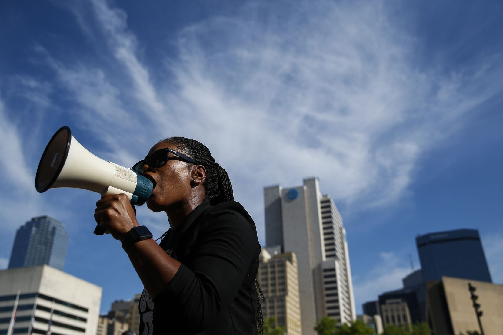 Shenita Cleveland calls to Mayor Eric Johnson for policy changes following a memorial service for George Floyd on Friday, June 5, 2020 at City Hall in Dallas.