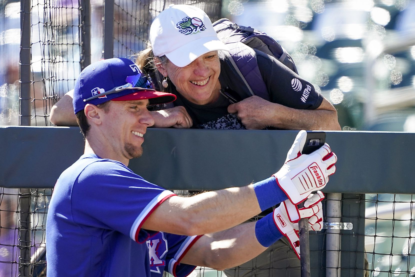 Texas Rangers infielder Matt Duffy takes a selfie with a fan before a spring training game against the Colorado Rockies at Salt River Fields at Talking Stick on Wednesday, Feb. 26, 2020, in Scottsdale, Ariz.