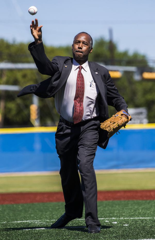 U.S. Secretary of Housing and Urban Development Ben Carson throws the first pitch for a youth baseball game that took place during a tour of the Dallas Housing Authority's Major League Baseball Youth Academy. (Ashley Landis/The Dallas Morning News)