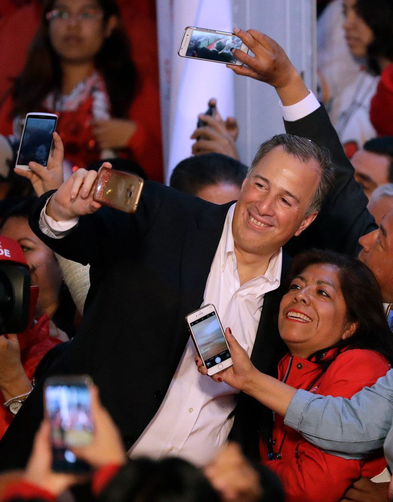 Jose Antonio Meade posed for selfies with supporters as he arrived for an event celebrating his registration as a candidate for the presidential nomination of the ruling Institutional Revolutionary Party in Mexico City on Dec. 3, 2017. Although not a party member, Meade got the support of most of the party's leaders at an event in which he registered, pretty much unopposed, for the party's nomination for the July 1 elections.