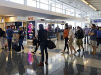 Passengers board a flight to Phoenix in Terminal D at Dallas-Fort Worth International Airport in May.