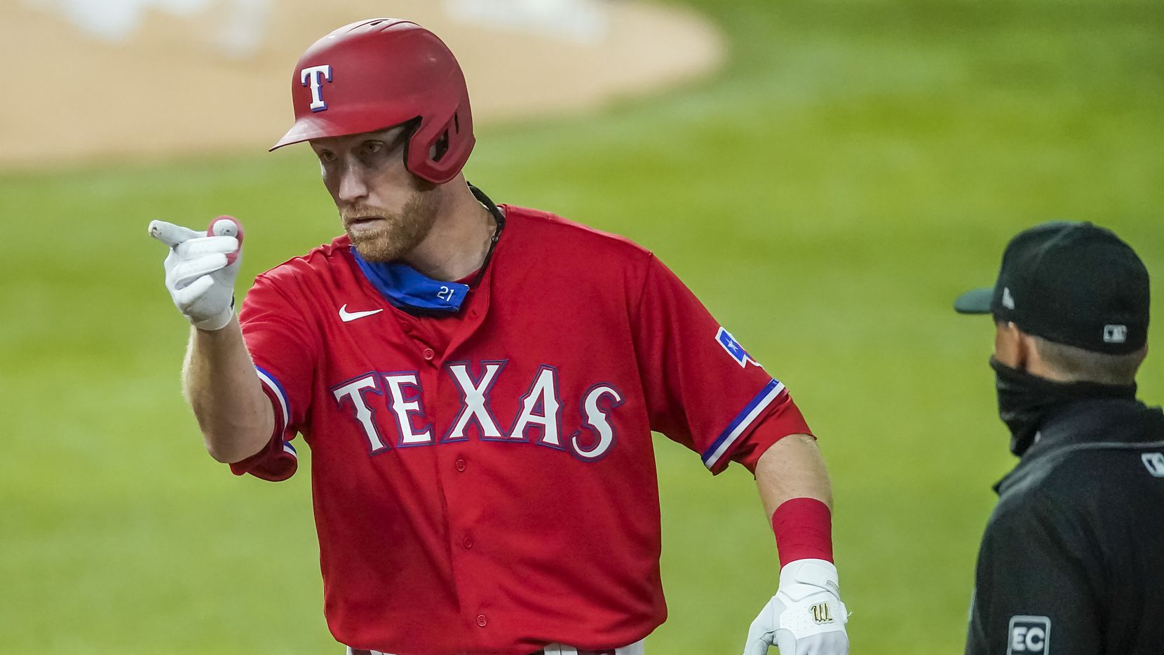 FILE - Rangers third baseman Todd Frazier celebrates after reaching base on a single during the second inning of a game against the Dodgers at Globe Life Field on Friday, Aug. 28, 2020.
