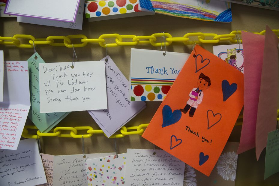 Scores of thank-you cards line the wall that caregivers see once they exit the intensive care unit in Parkland's COVID-19 Tactical Care Unit.