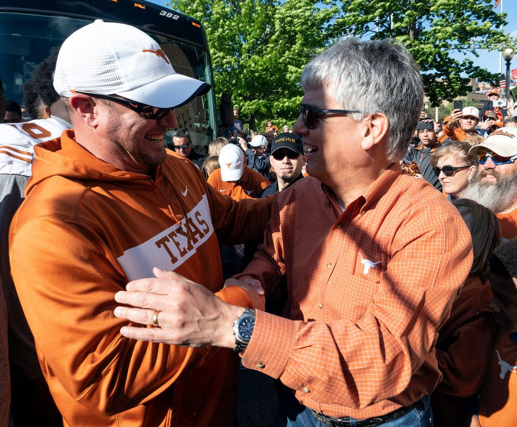 University of Texas head coach, Tom Herman, and University of Texas at Austin President, Gregory L. Fenves, great each other at the team bus before the Longhorns football team marched along Bevo Boulevard and fans to the team locker room before the start of the Orange and White spring game held at Darrel K Royal Texas Memorial Stadium on Saturday, April, 13, 2019, in Austin, Texas.  (Rodolfo Gonzalez/ Special Contributor)