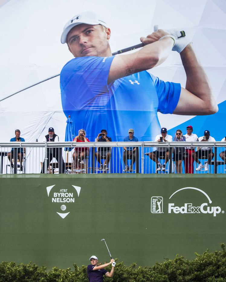 Jordan Spieth tees off on the second hole under a giant photo of himself on the side of the FanDome during the first round of the 2017 AT&T Byron Nelson Championship on May 18 at the TPC Four Seasons in Irving.
