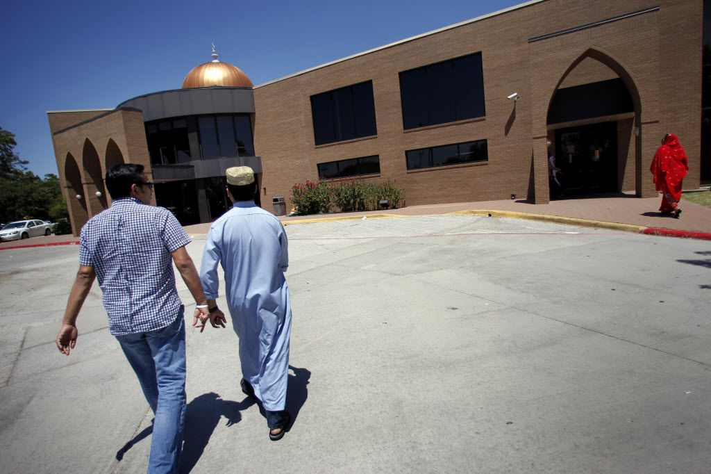 Rais Bhuiyan and close friend, Munir Kamal, (left) attend prayers at the Islamic Association of North Texas Dallas Central Mosque in Richardson.