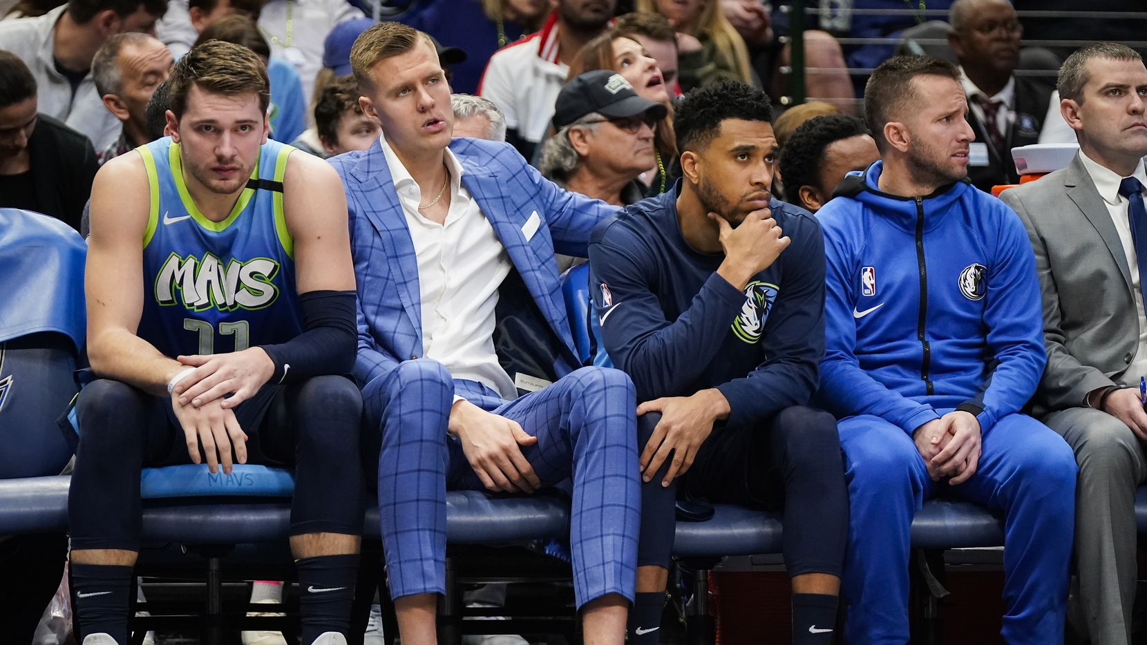 Dallas Mavericks guard Luka Doncic (left) and injured Kristaps Porzingis watch from the bench during the first half of an NBA basketball game against the Los Angeles Lakers at American Airlines Center on Friday, Jan. 10, 2020, in Dallas.