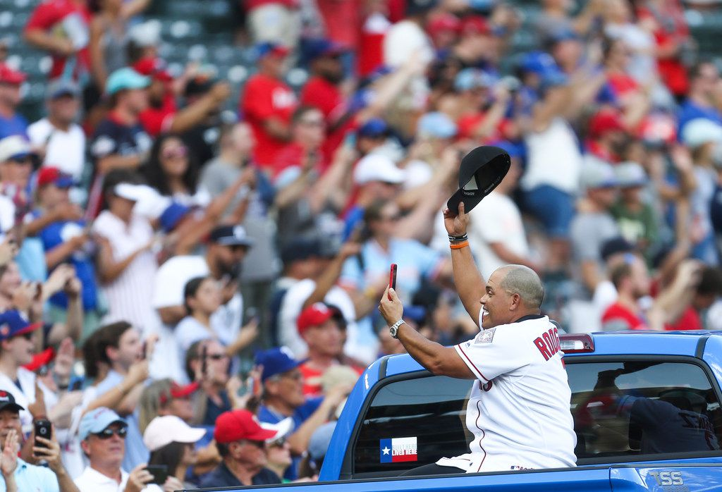 "Former Texas Rangers catcher Ivan ""Pudge"" Rodriguez cheers on as he rides in a parade as the home plate is moved form Globe Life Park  to Globe Life Field on Sunday, September 29, 2019 in Arlington, Texas."