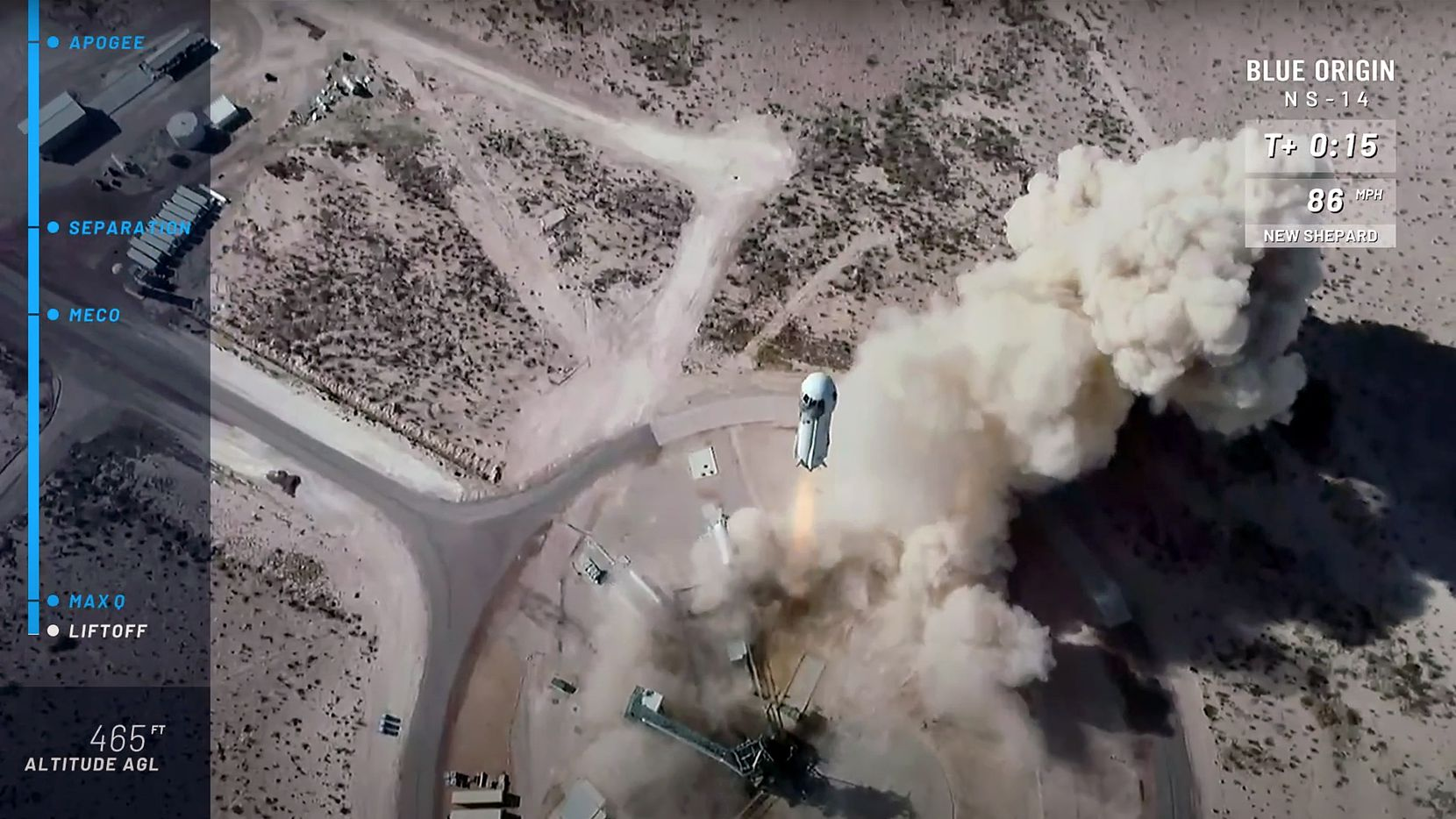 This frame grab from Blue Origin's livestream Thursday shows its New Shepard rocket blasting off in West Texas on its 14th mission.