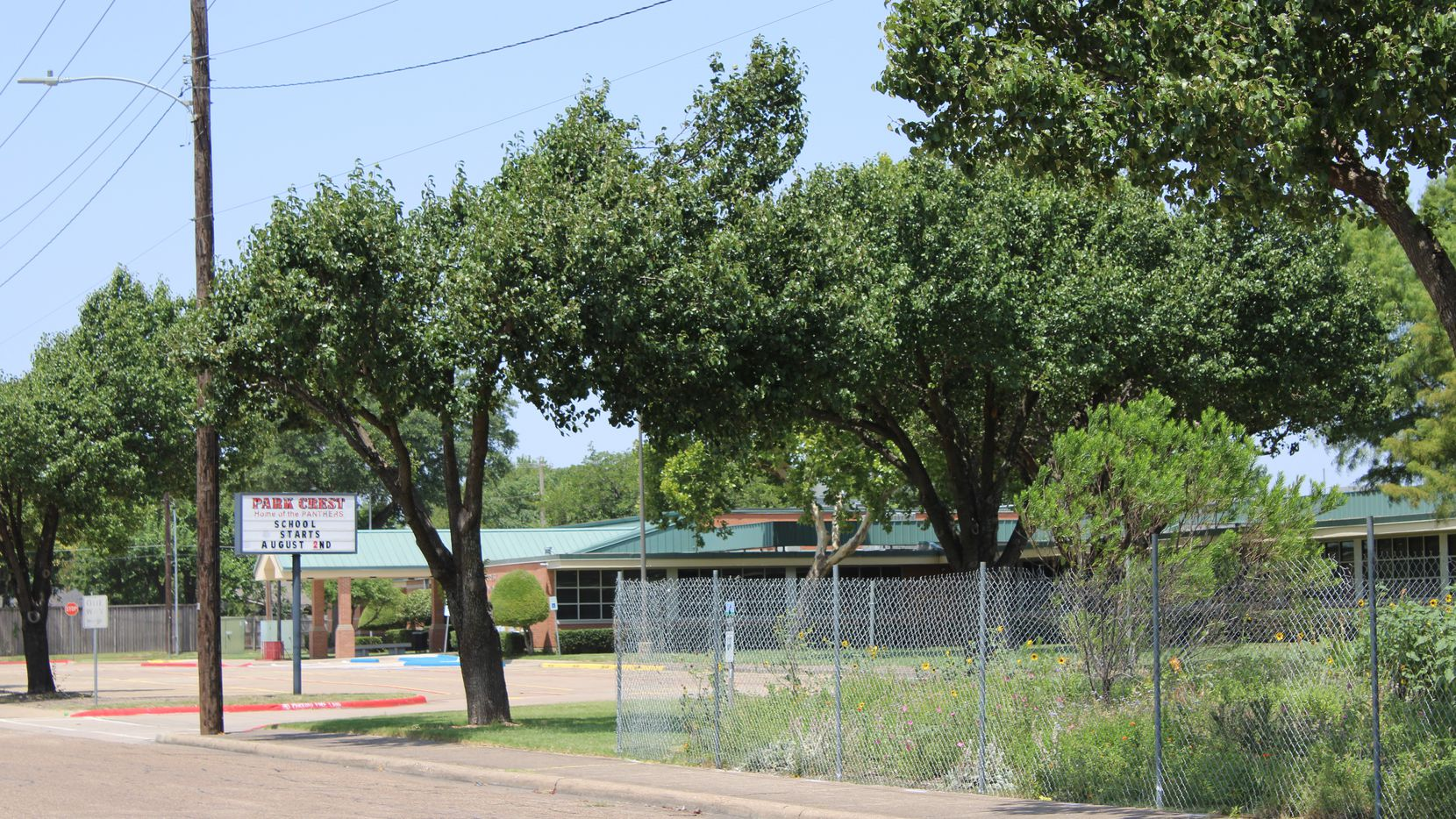 A company placed fencing around a garden at Park Crest Elementary School in July. Trustees voted on Sept. 28 to pay an independent contractor nearly $70,000 to test soil at Sam Houston Middle School — which is across the street from Park Crest — for elevated levels of arsenic and lead.