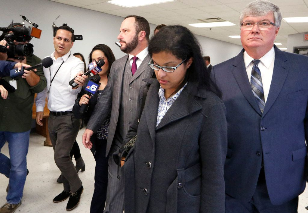 Sini Mathews leaves Judge Cheryl Lee Shannon's courtroom, where she learned that her 4-year-old daughter  will remain in foster care. The judge rescheduled a new hearing for Nov. 29. She is surrounded by her attorneys. Sini Mathews is the mother of Sherin Mathews, who was found dead in a Richardson culvert.