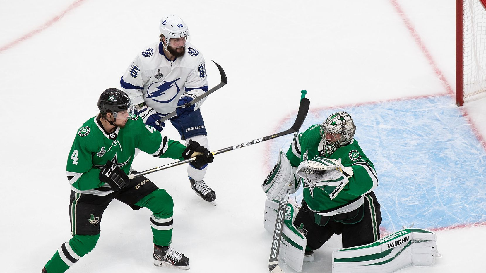 Miro Heiskanen (4) and goaltender Anton Khudobin (35) of the Dallas Stars defend against Nikita Kucherov (86) of the Tampa Bay Lightning during Game Three of the Stanley Cup Final at Rogers Place in Edmonton, Alberta, Canada on Wednesday, September 23, 2020.