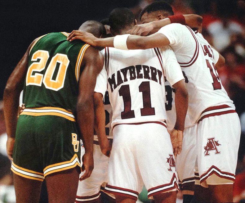 March 10, 1990--Baylor University's Michael Williams joins the Arkansas huddle during a break in play in the Southwest Conference Basketball Tournament at Reunion Arena in Dallas. (Louis DeLuca/Dallas Times Herald)