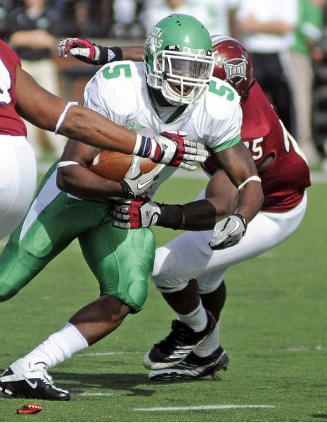 North Texas running back Lance Dunbar (5) runs with the ball during the first half of the college football game against Troy on Saturday, Nov. 12, 2011, in Troy, Ala.
