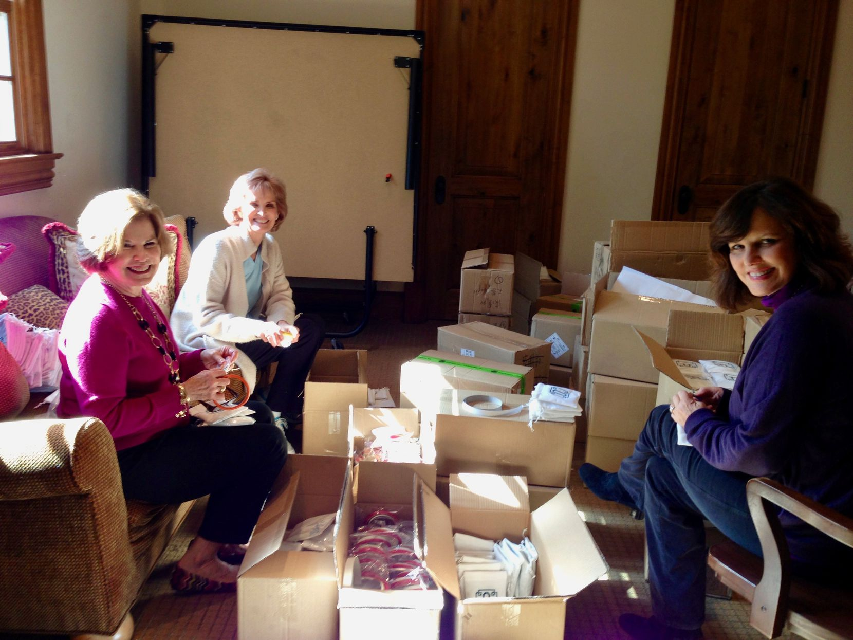 From left: Janie Cooke's mother, Jane Dunne, Caroline Nix's mother, Josie Heath, and their friend Susan Brown helped pack Big O Key Rings in a converted playroom at Nix's Preston Hollow home in November 2012.