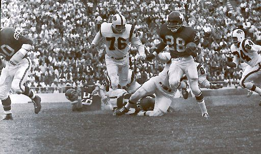 Dallas Texans running back Abner Haynes scampers around left end in the first quarter of a December 1962 game against the  Buffalo Bills at the Cotton Bowl in Dallas. The Chiefs won the American Football League title that season averaged only about 10,000 fans a game at the Cotton Bowl, so Texans owner Lamar Hunt moved the club to Kansas City in 1963 and renamed them the Chiefs.