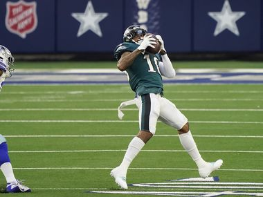 Philadelphia Eagles wide receiver DeSean Jackson (10) hauls in a touchdown  pass past Dallas Cowboys cornerback Chidobe Awuzie (24) during the first quarter of an NFL football game at AT&T Stadium on Sunday, Dec. 27, 2020, in Arlington.