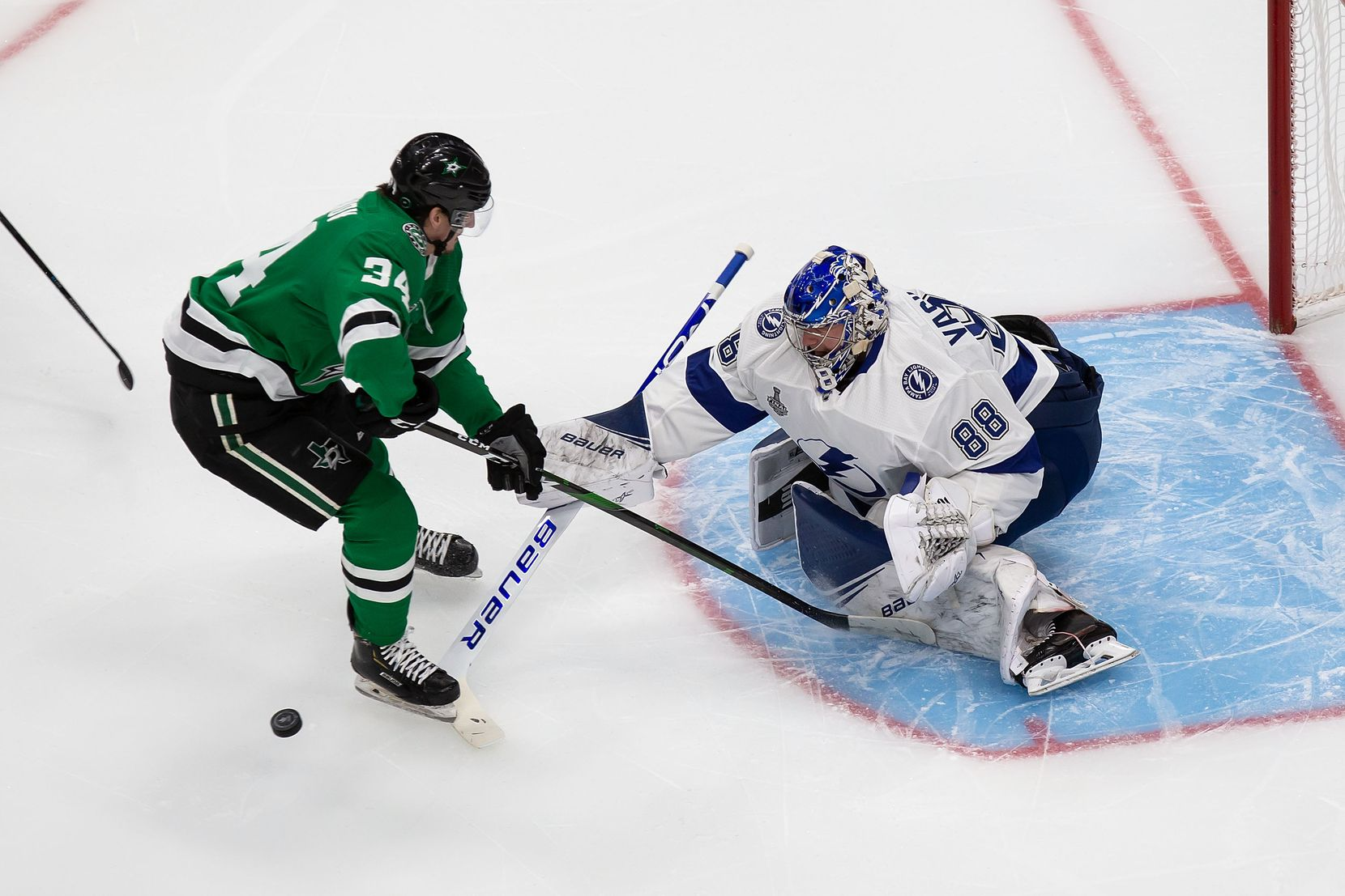 Denis Gurianov (34) of the Dallas Stars takes a shot against goaltender Andrei Vasilevskiy (88) of the Tampa Bay Lightning during Game Three of the Stanley Cup Final at Rogers Place in Edmonton, Alberta, Canada on Wednesday, September 23, 2020. (Codie McLachlan/Special Contributor)