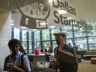 Participants work in a lounge area during Dallas Startup Week activities on Tuesday, April 12, 2016 at 1700 Pacific Avenue in Dallas.
