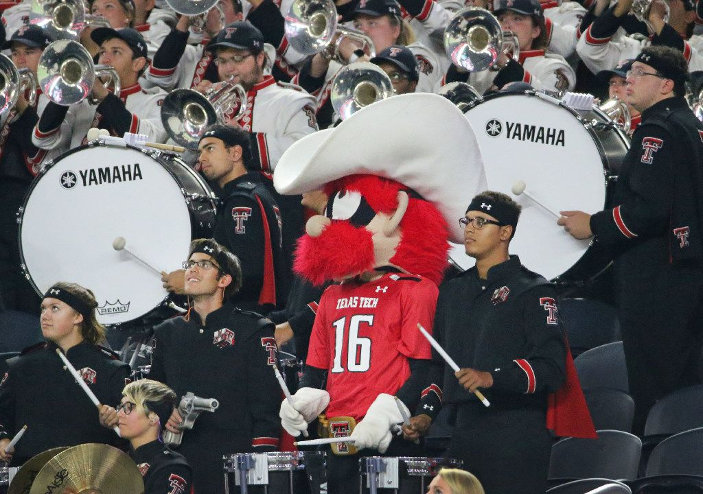 The Red Raiders mascot sits in with the Red Raider band drum line in the second quarter during the Baylor University Bears vs. the Texas Tech University Red Raiders NCAA football game at AT&T Stadium in Arlington, Texas on Friday, November 25, 2016. (Louis DeLuca/The Dallas Morning News)