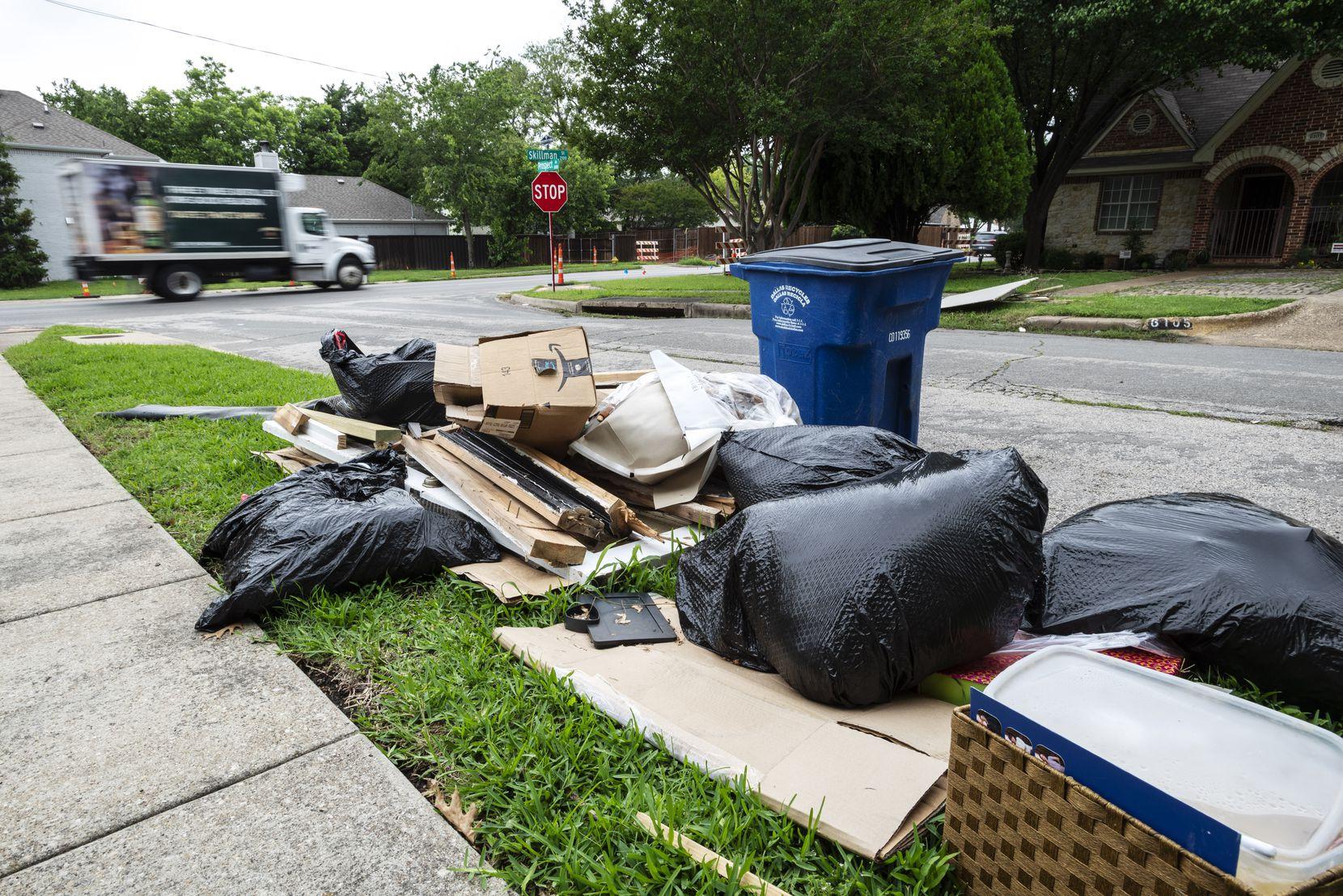 Bulk trash is near a curb on Prospect Avenue and Skillman Street in Dallas, on June 08, 2021.