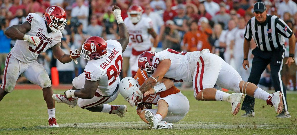 Texas Longhorns quarterback Shane Buechele (7) is sacked by Oklahoma Sooners defensive tackle Marquise Overton (97) in the fourth quarter during the Oklahoma University Sooners vs. the University of Texas Longhorns NCAA college football game at the Cotton Bowl in Dallas on Saturday, October 14, 2017. (Louis DeLuca/The Dallas Morning News)