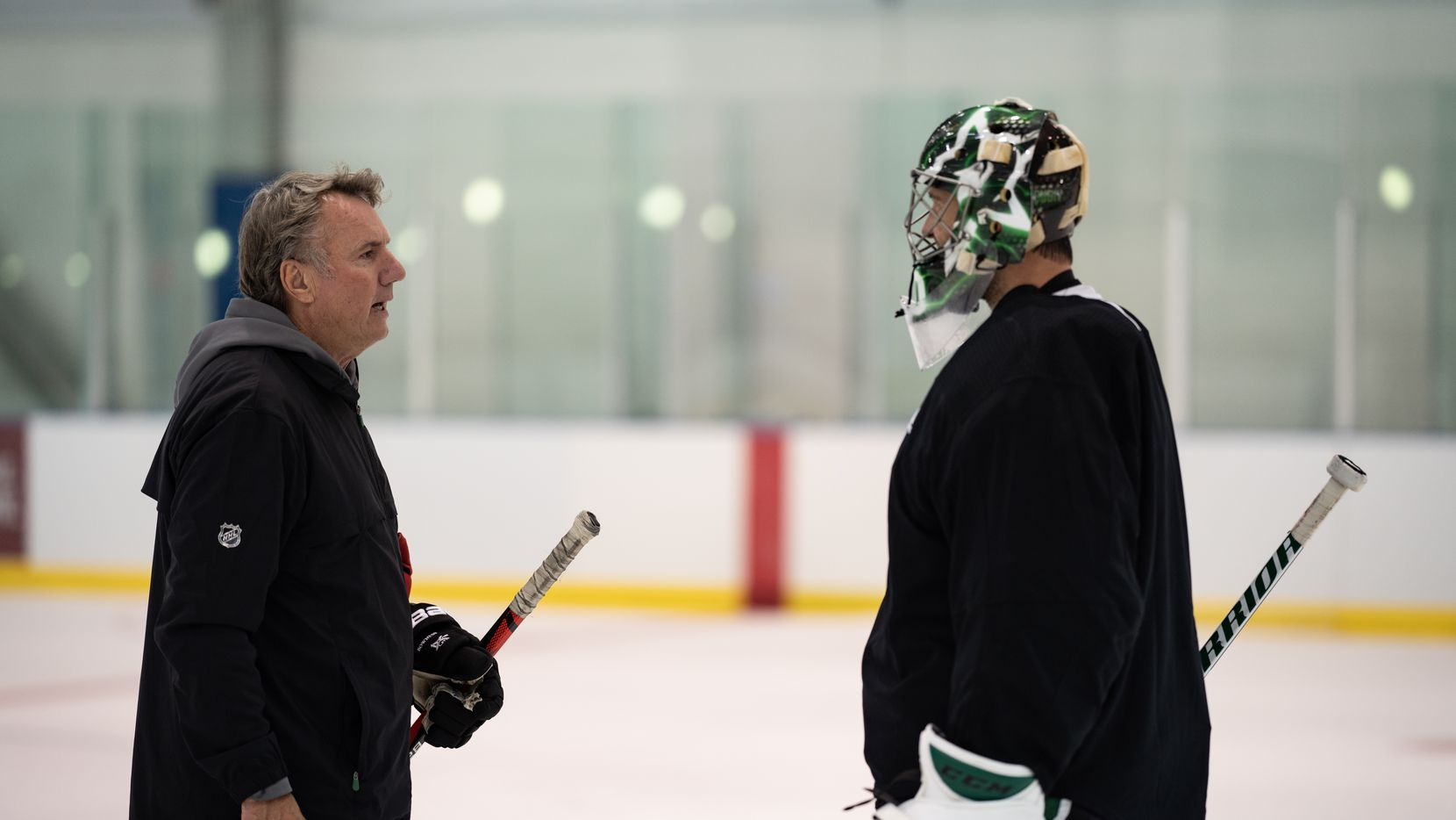 Dallas Stars interim head coach Rick Bowness talks with goalie Ben Bishop as the Dallas Stars work out in their 'bubble' in Edmonton, in Alberta, Canada, on July 28, 2020.