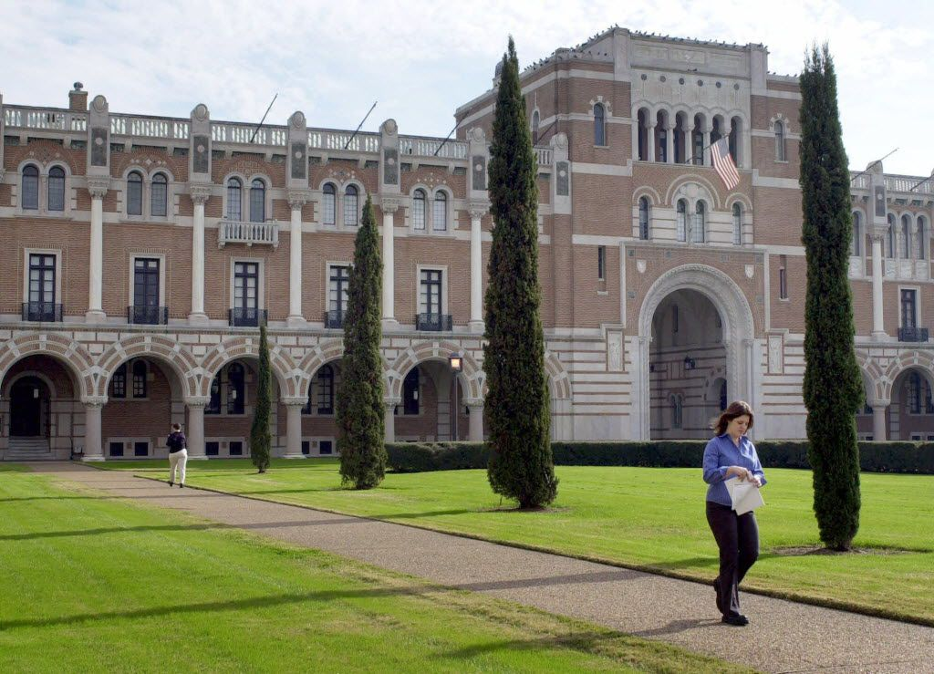 An unidentified woman walks past Rice University's Lovett Hall, the oldest building on campus, Tuesday, Jan. 23, 2001, in Houston. Classes commenced at Rice on Sept. 23, 1912, 12 years after the death of its benefactor, William Marsh Rice. (AP Photo/Pat Sullivan) ORG XMIT: HT102