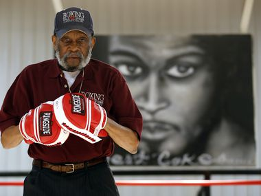 Longtime boxing trainer and former welterweight champion Curtis Cokes was on hand for the grand re-opening and ribbon cutting of the multipurpose Life Center at the Village Oaks Apartments in southern Dallas, Wednesday, January 22, 2014.  The Center provides the surrounding neighborhood with a workout facility and sports leagues, boxing programs, and life skills programs.