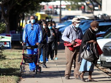 Voters in Oak Cliff wait to cast ballots on Oct. 13, the first day of early voting for the 2020 election.