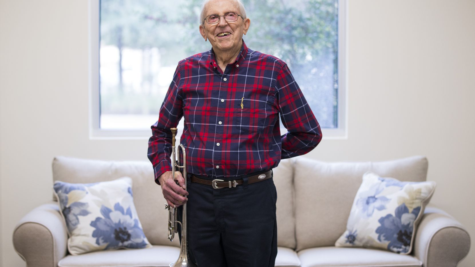 "John Gould, 94, holds his trumpet while posing for a portrait in a common area of The Overlook at CC Young retirement community on Saturday. His advice for us during the coronavirus virus: ""Take it easy, pray for each other and look after your neighbors, even if you don't know them that well -- especially those who are lonely or really fragile."""
