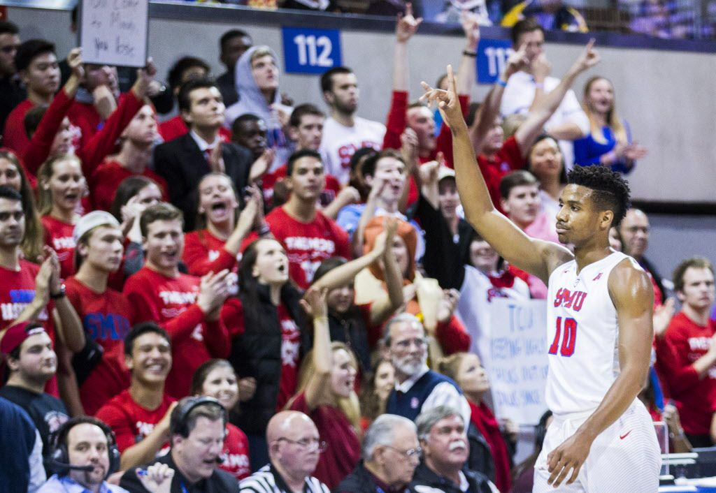 Southern Methodist Mustangs guard Jarrey Foster (10) celebrates late in the second half as head coach Tim Jankovich pulls all of the starters from their game against the TCU Horned Frogs on Wednesday, December 7, 2016 at Moody Coliseum on the SMU campus in Dallas. SMU won 74-59. (Ashley Landis/The Dallas Morning News)